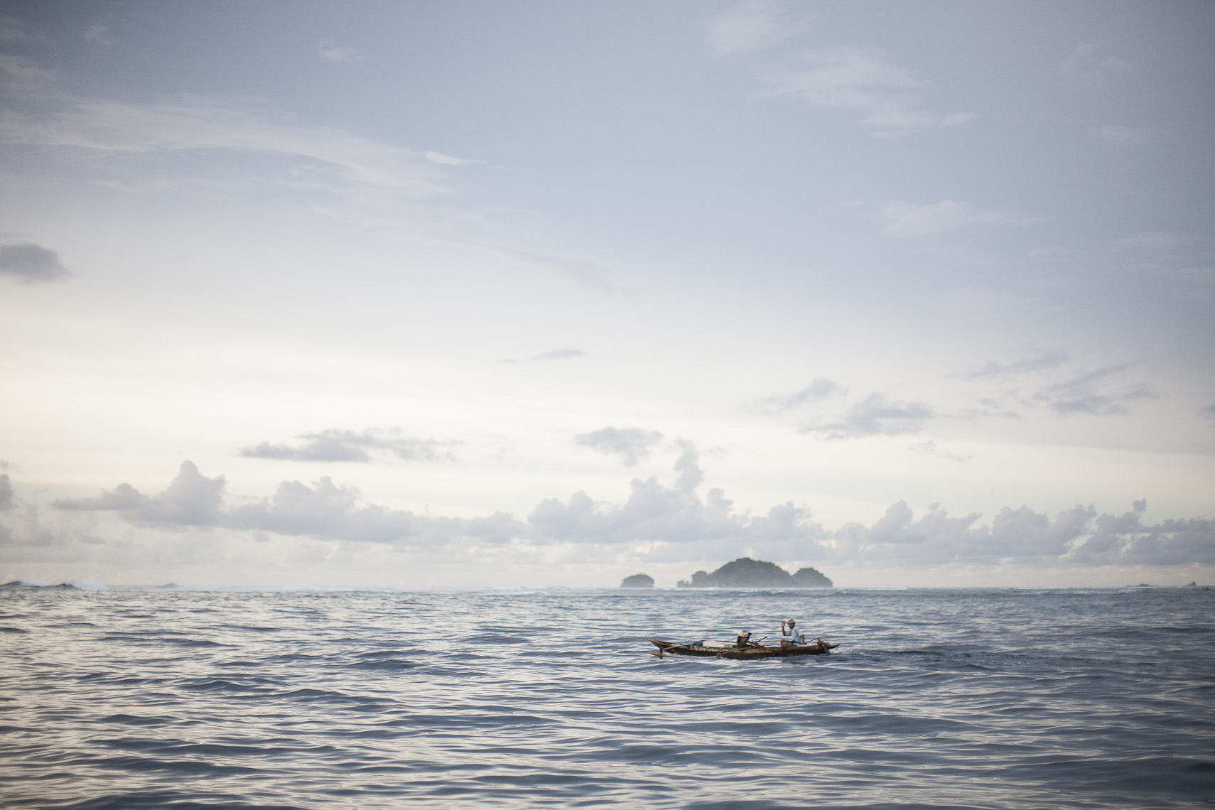 Small Canoe in Vast Ocean